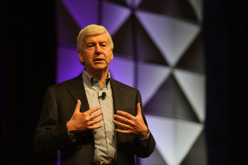 Governor Rick Snyder addressing the North American International Cyber Summit in 2016. Should he have pulled the plug on free water bottle distribution in Flint?