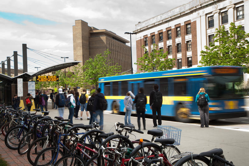 University of Michigan students wait for a bus