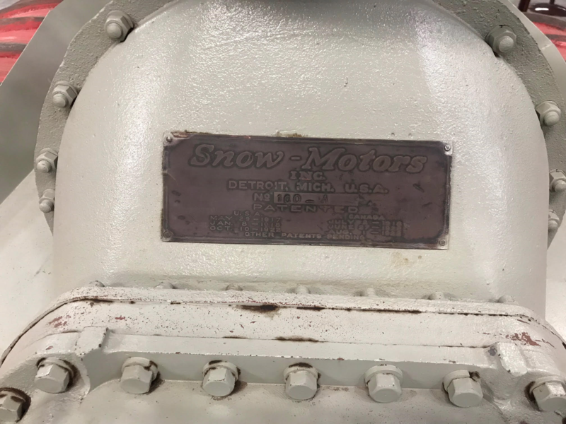 The branded label on the front of a snow motor