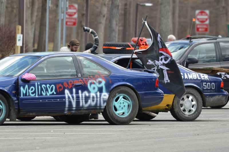 A crappy blue sedan with graffittii and a pirate flag, ready to rock for the Gambler 500