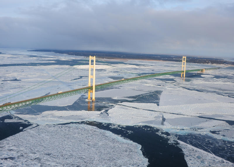 aerial view of bridge and icy water