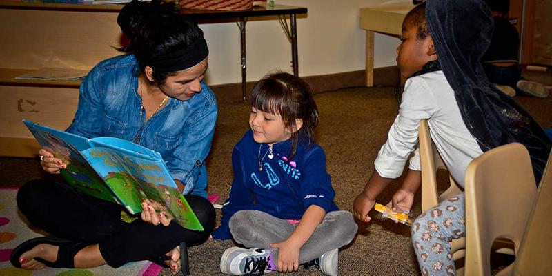 In a neighborhood in southwest Grand Rapids, teacher Lorena Lopez leads a group of 4-year-old students.