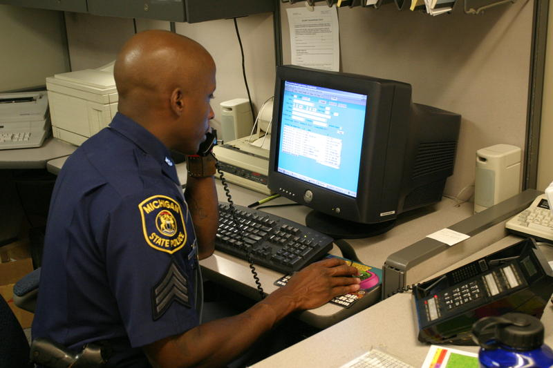 Michigan State Police officer at computer