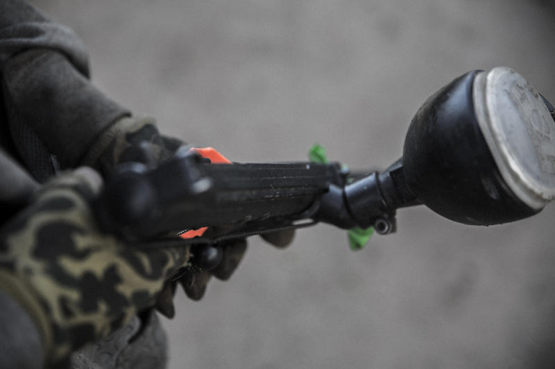 A paintball gun in camoflaged hands