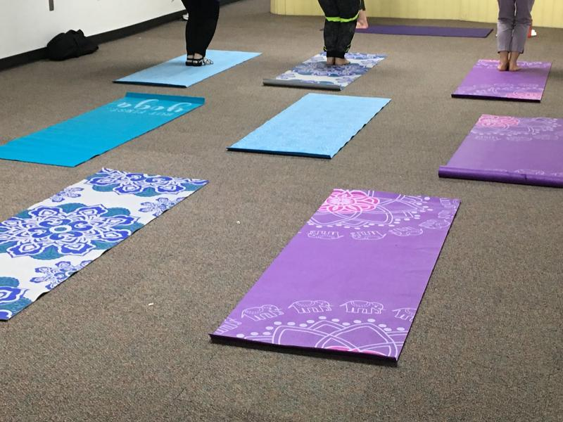 Yoga mats set out and ready for the class to begin