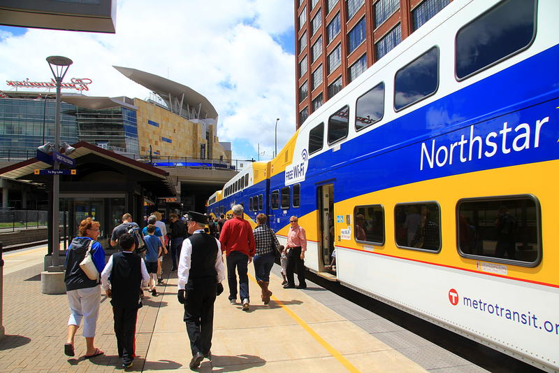 Passengers prepare to board the high-speed rail in Minneapolis
