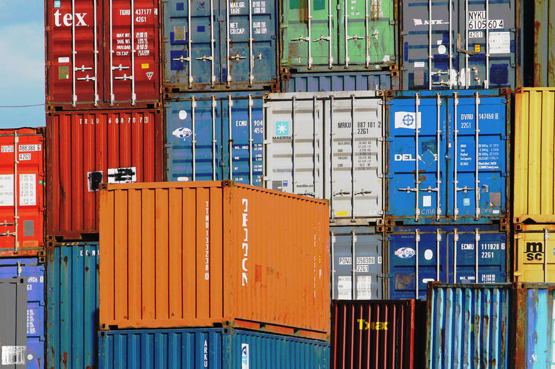 multicolored shipping containers in a ship yard with imported goods