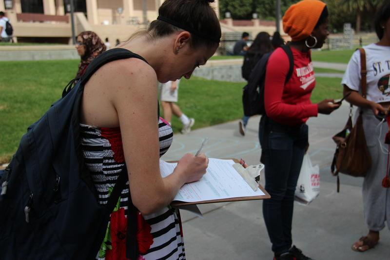 young people register to vote on campus