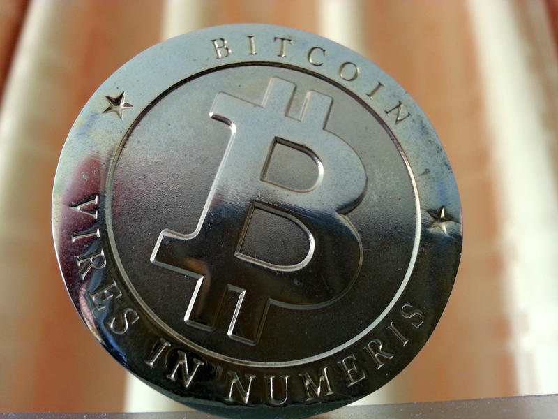 An image of a silver bitcoin