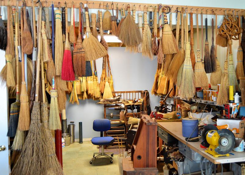 Some of the many designs of brooms in Henry Tschetter's shop.