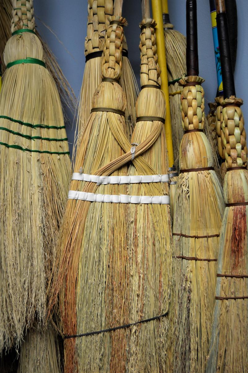 The middle broom uses a forked limb as a broomstick.