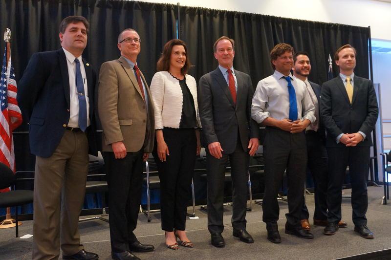 Candidates for governor, from left: State Senator Patrick Colbeck (R), Doctor Jim Hines (R), Former state Senator Gretchen Whitmer (D), Michigan Attorney General Bill Schuette (R), Shri Thanedar (D), Abdul El-Sayed (D), Brian Calley (R).