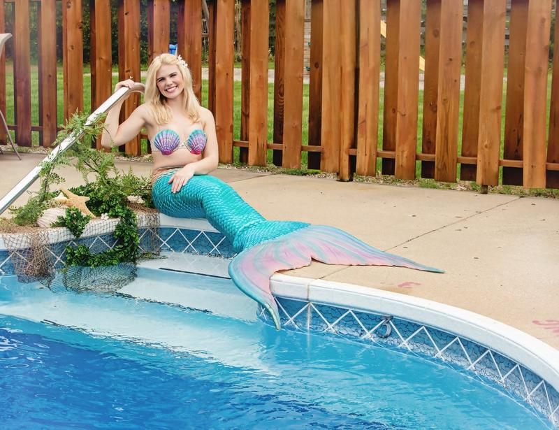 Sadie Johnson as Sadie Mermaid posing by a pool