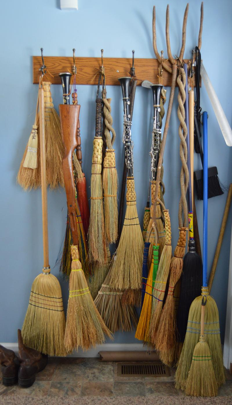 The broom with the blue handle (on the right) was made while the interview was conducted.