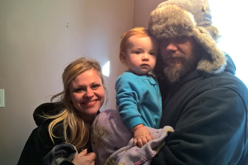 Nicole Hrosch and Jeff Crowe, with their son Christopher.