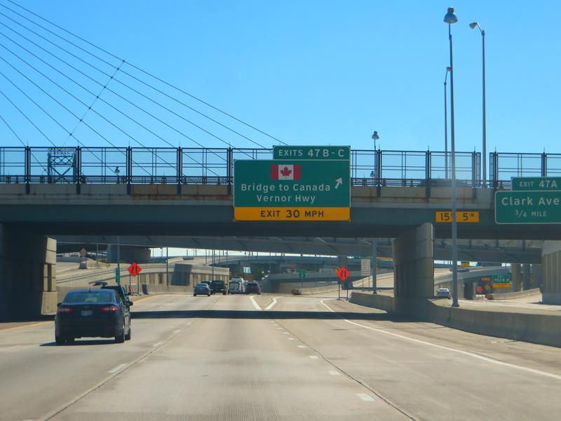 An image of the highway sign for the bridge to Canada in Detroit