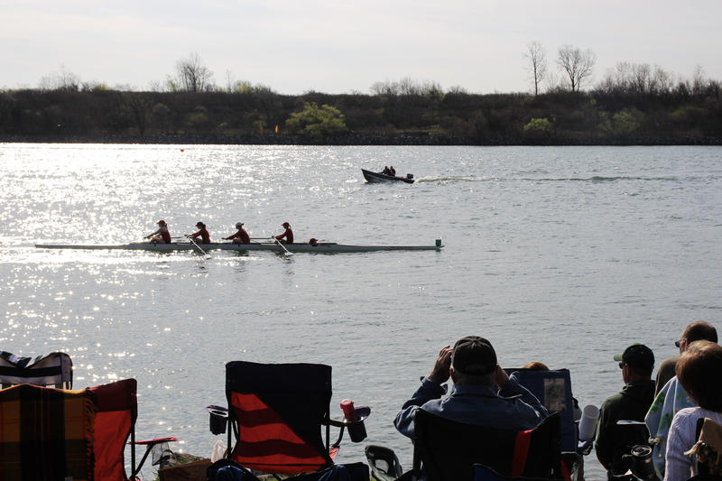 Fans watching rowers on the Detroit River