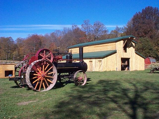 A barn and tractor at the farm
