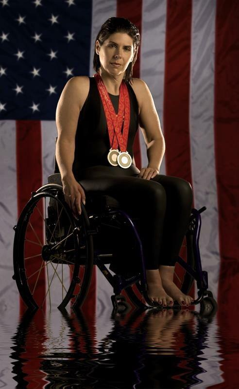 Cheryl Angelelli displaying her Paralympic medals for swimming