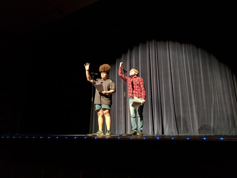 Two students on stage