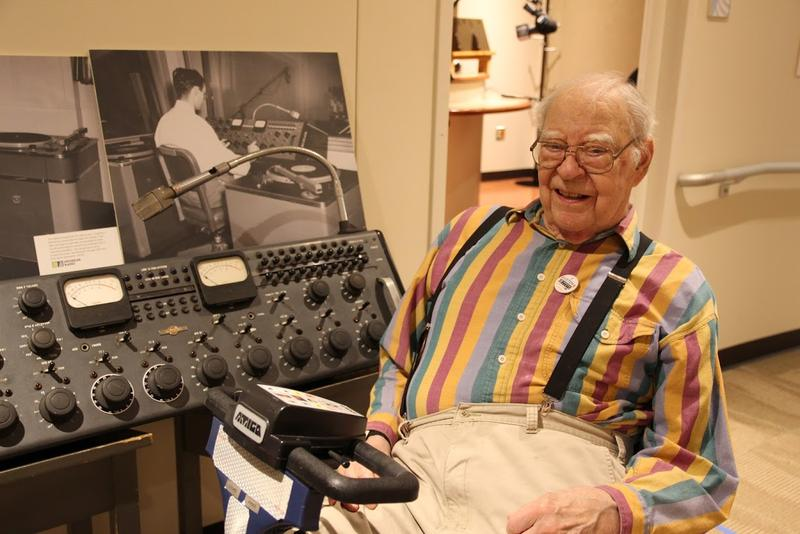 Fred Remley, engineer at the station beginning in 1948, with the control board he used. Behind is a photo of himself using this very control board in 1948. This photo was taken at Michigan Radio's 70th Anniversary Picnic.