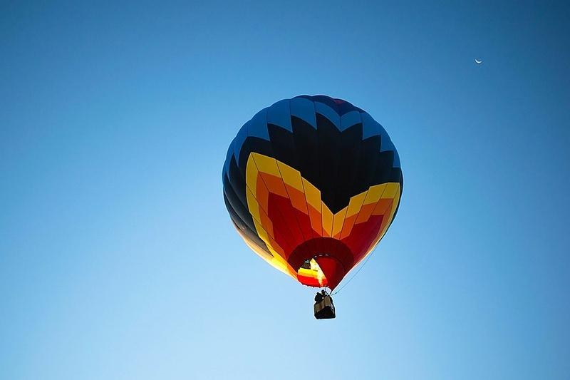 multi-colored hot air balloon in blue sky