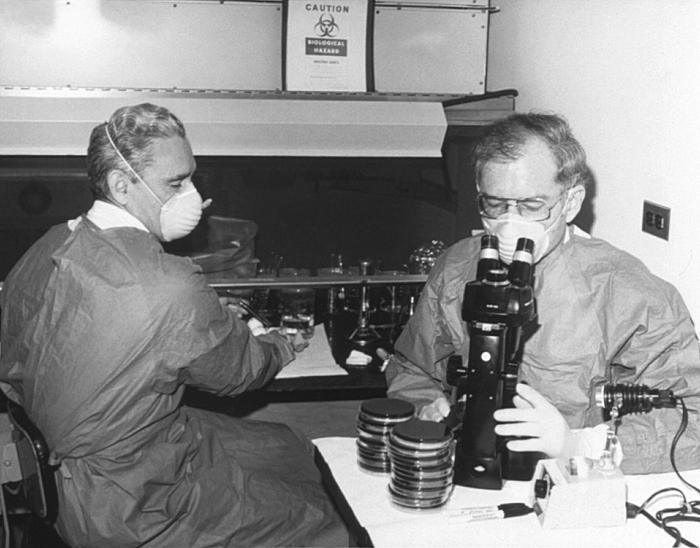 Centers for Disease Control (CDC) laboratorian George Gorman at left, along side Dr. Jim Feeley, while they were examining culture plates, i.e., Petri dishes, upon which the first environmental isolates of Legionella pneumophils had been grown.