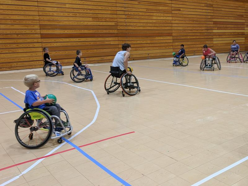 Kids playing wheelchair dodgeball