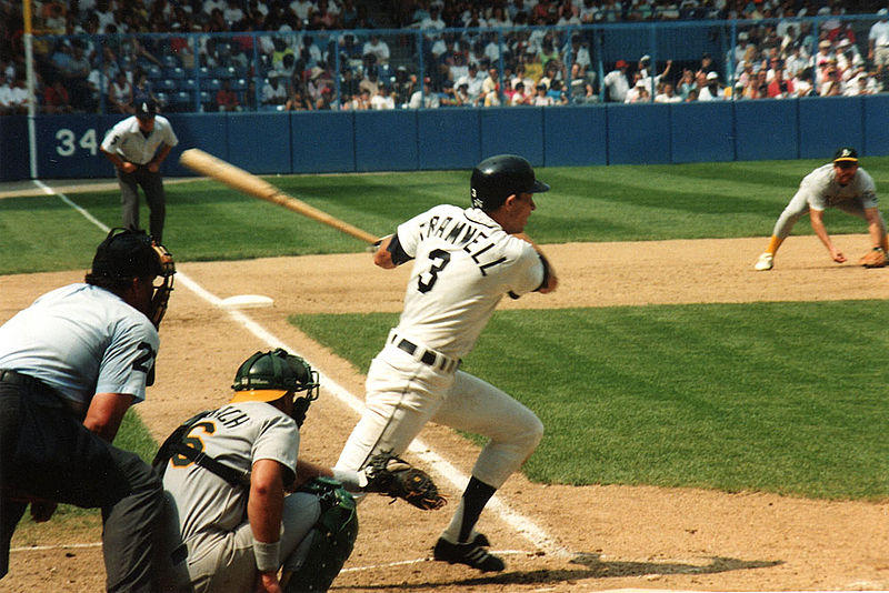 Former Detroit Tiger Alan Trammell swinging the bat during a game in 1991.