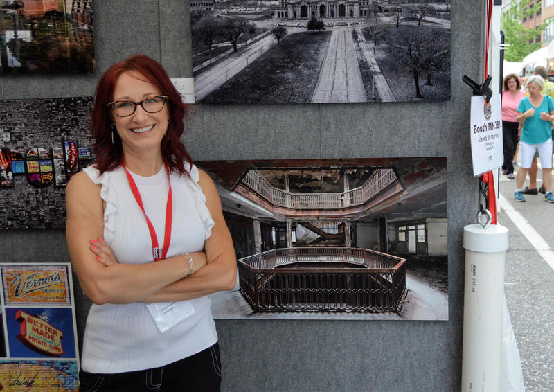 Allana St. Laurents standing in front of photographs