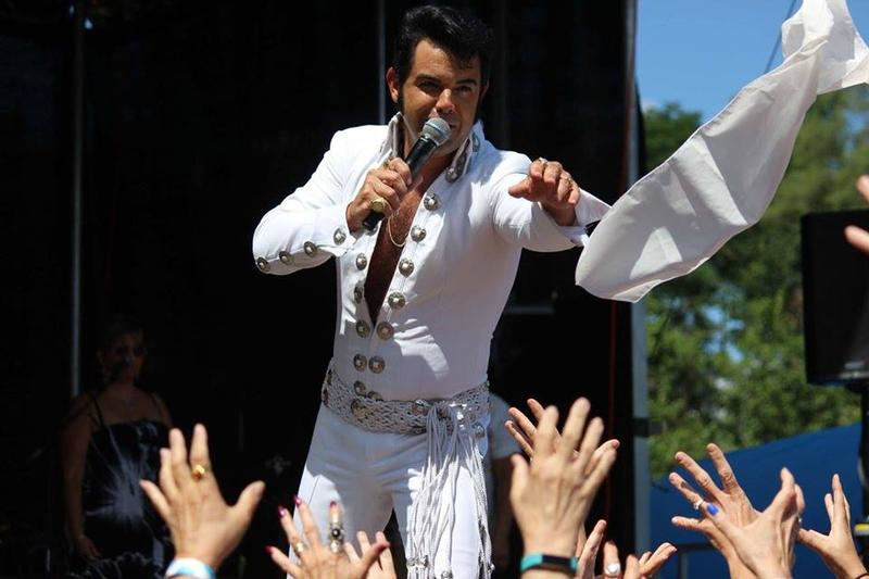 a white scarf being thrown into a crowd of Elvis fans at Elvisfest