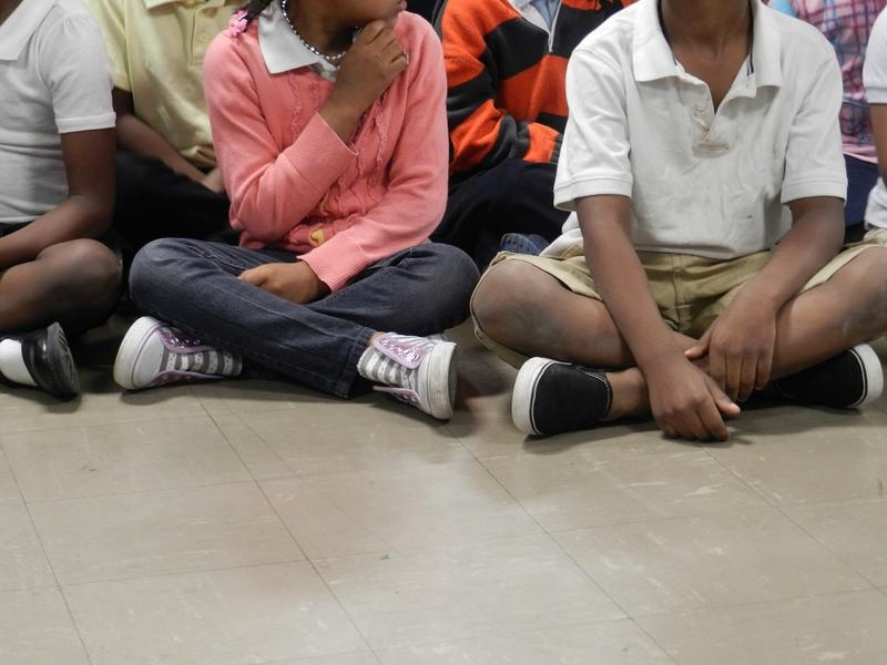 children sitting on floor