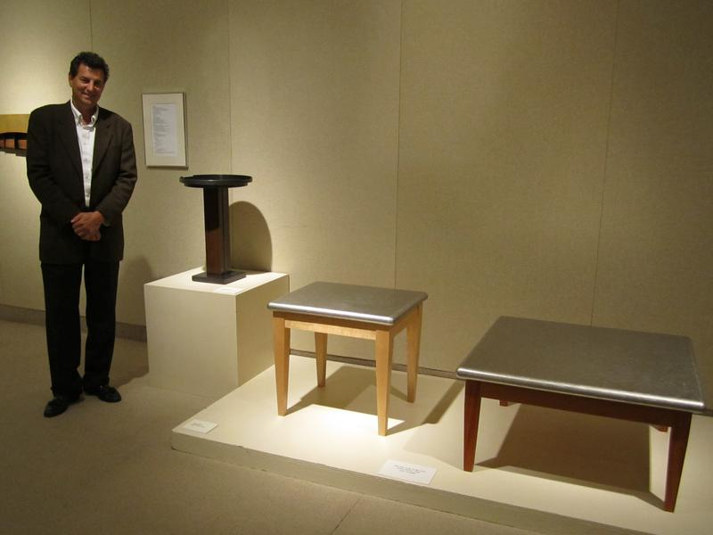 Steven Mark Fidler with metal and wood occasional tables.