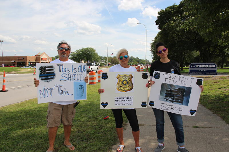 A group demonstrating in support of police