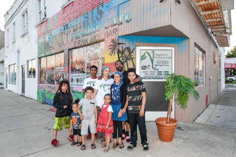 Mujahid Allah and his family in front of their restaurant, Veginnini's