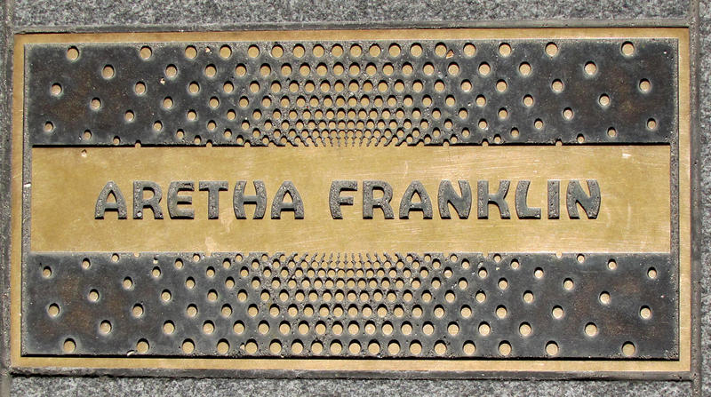 A sidewalk plaque outside the Apollo Theater in New York City.