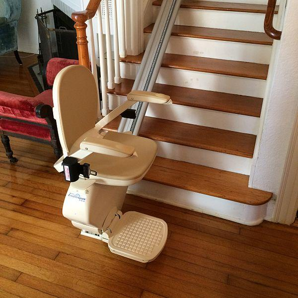 chair lift at bottom of stairs