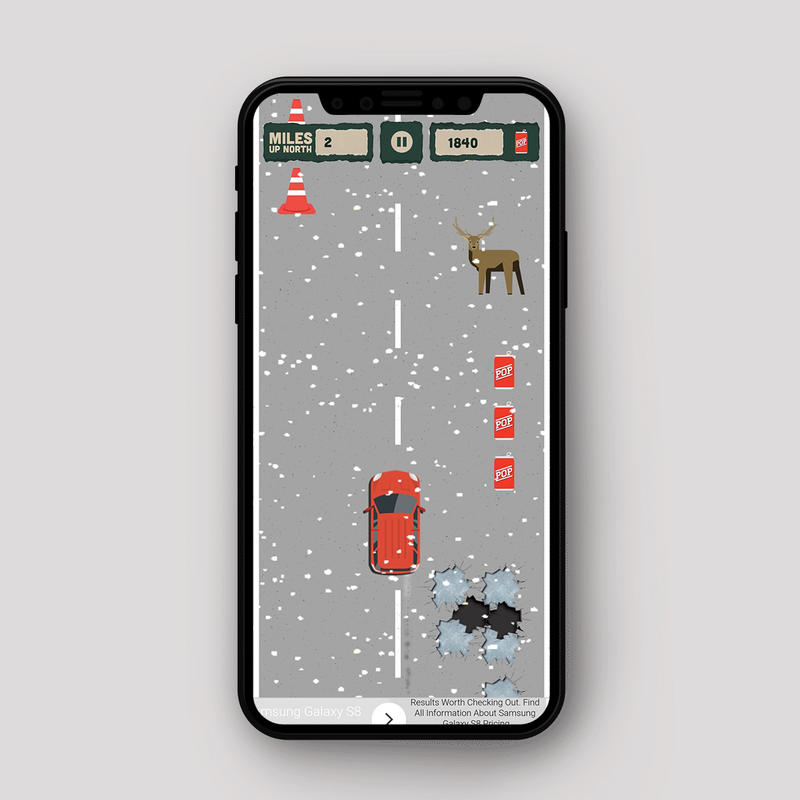 A screenshot from the Get Up North app with a car driving on a snowy road, avoiding a deer and a pothole