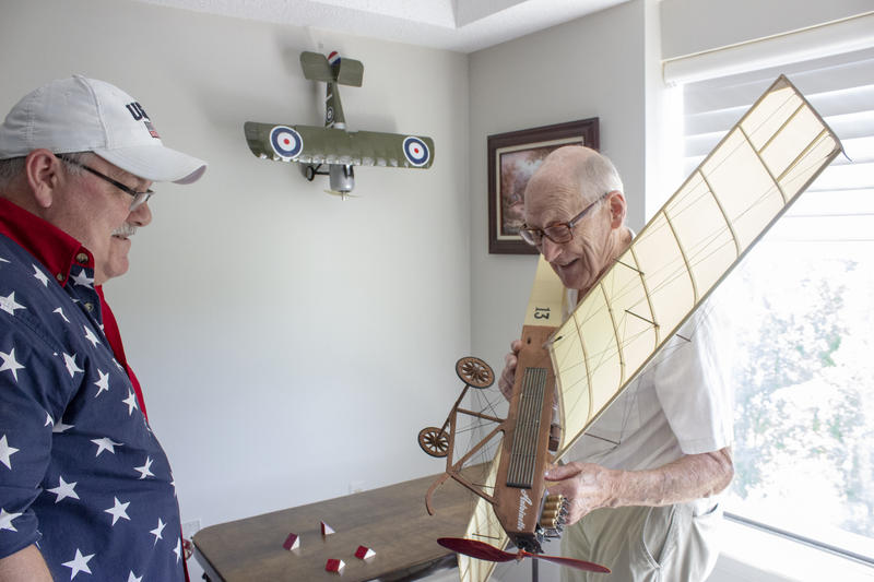 Sean Tracy visits a veteran in a senior living community.