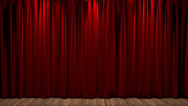 Ruby red theater curtains with lights