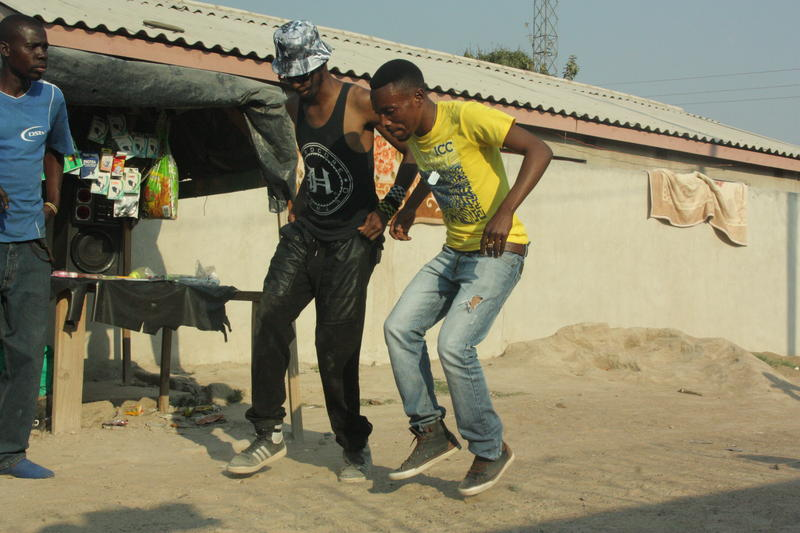 "Haleem ""Stringz"" Rasul dances with Zimbabwe dancer Francis ""Franco Slomo"" Dhaka during a trip to Zimbabwe"