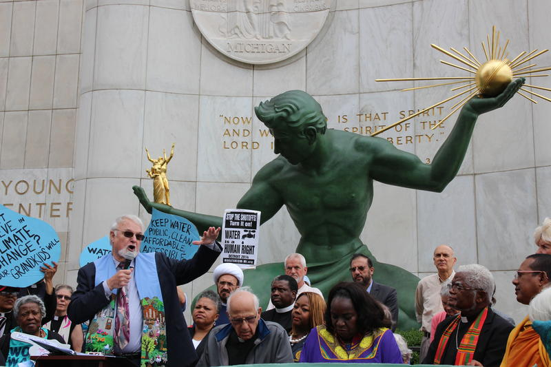 Reverend Ed Rowe, pastor emeritus of Central United Methodist Church speaks at a rally of Detroit faith leaders in front of the Spirit of Detroit.