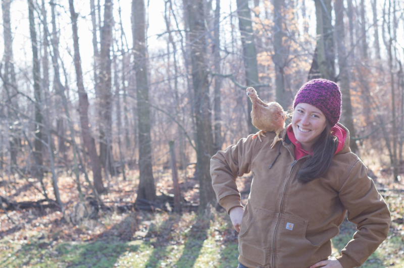 Allie Thorp, co-founder of Trillium Wood Farm, pictured with a chicken on her shoulder.