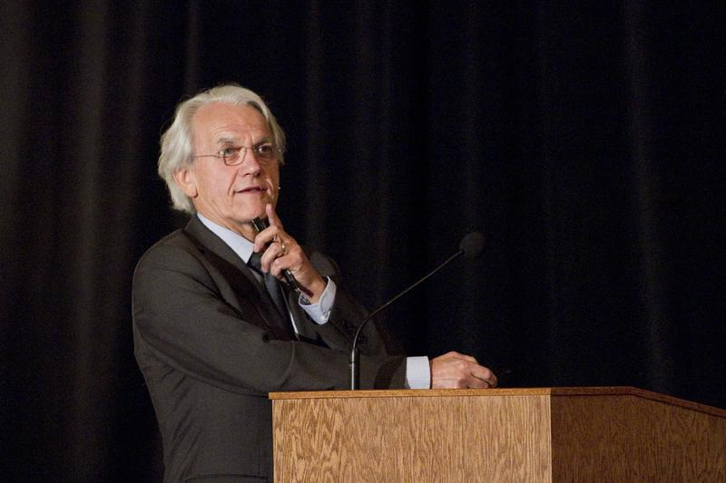 Dr. Gérard Mourou speaking at a University of Michigan event.