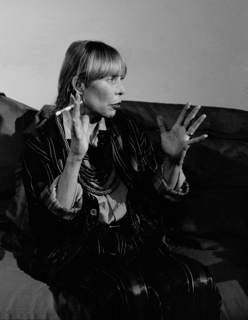 Image of Joni Mitchell smoking a cigarette.