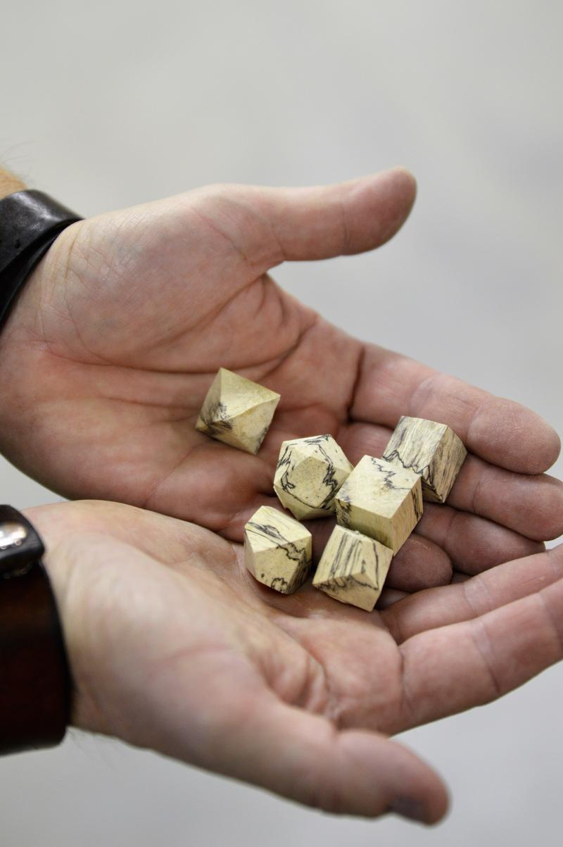 Wooden dice are among the many gaming accessories produced by Dog Might Games.