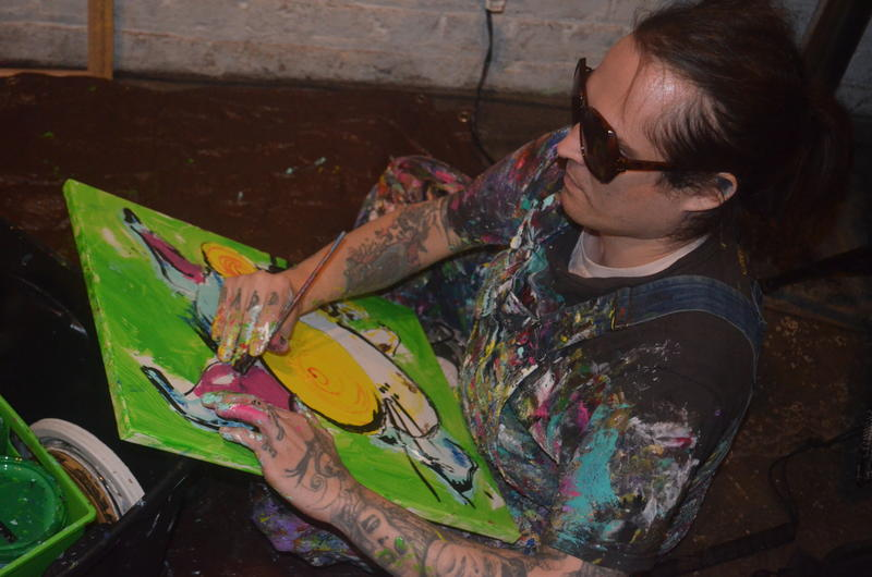 Brendan painting bunny rabbit at Tangent Gallery for Blindsided fundraiser for Cystic Fibrosis