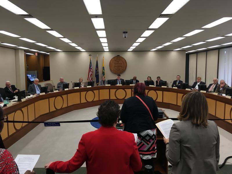 Attorneys speaking at meeting