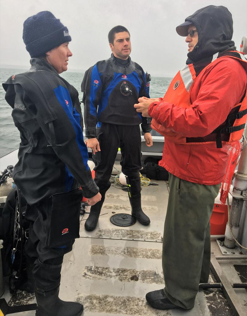 NOAA Chief Scientist Ed Johnson briefs NOAA divers Stephanie Gandulla (left) and Phil Hartmeyer (middle), on the mission objectives for their Niagara River dive near Lake Ontario.
