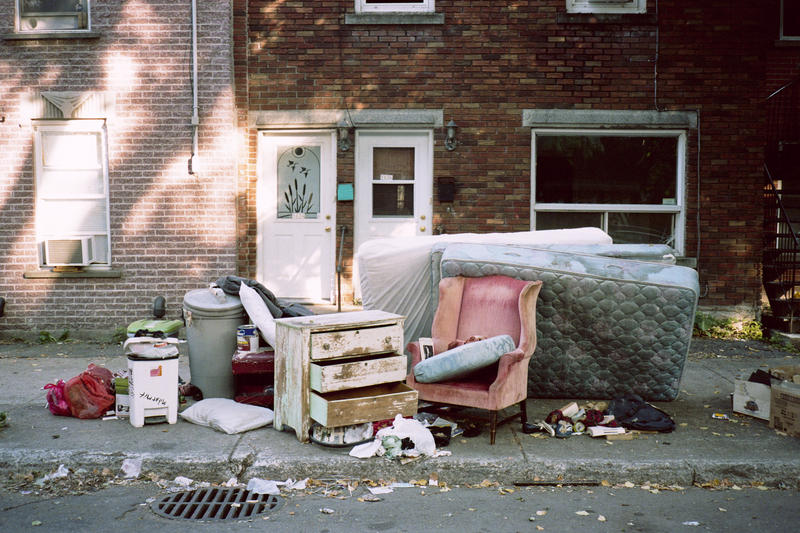 image of furniture and mattresses on curb